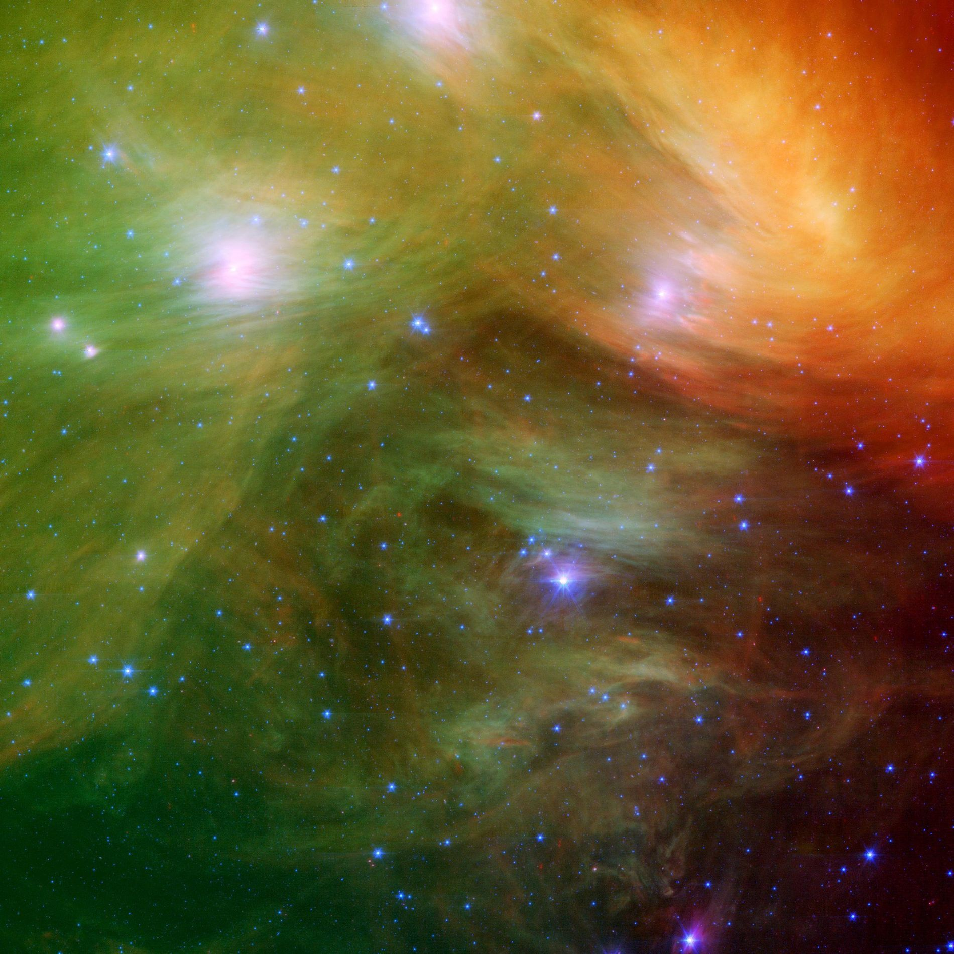The Seven Sisters, also known as the Pleiades star cluster, shines through colorful clouds of dust ...