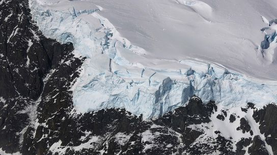 Ice meets rock in the Antarctic Peninsula, in a picture taken by NASA's Operation IceBridge in ...