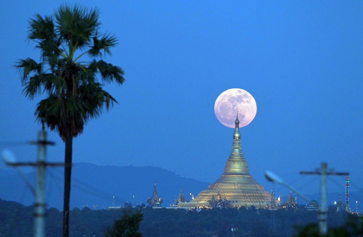 The supermoon rises behind the Uppatasanti Pagoda seen from Naypyitaw, Myanmar.
