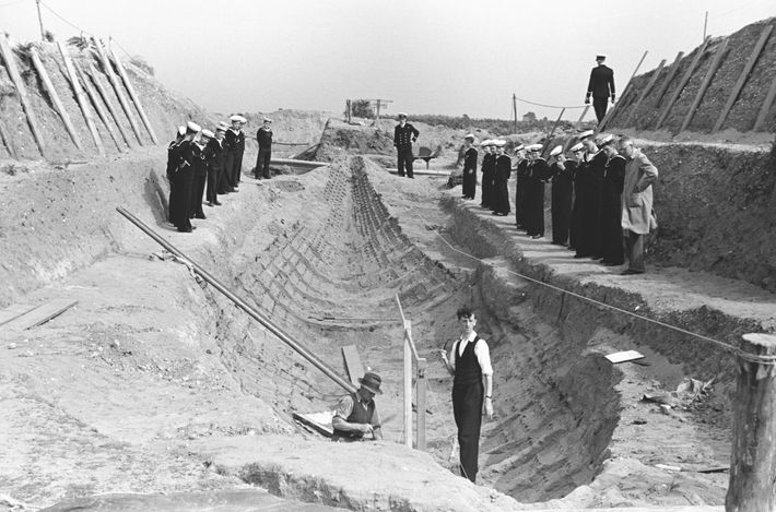 A photo from the original Sutton Hoo excavation shows the remains of the wooden ship that ...