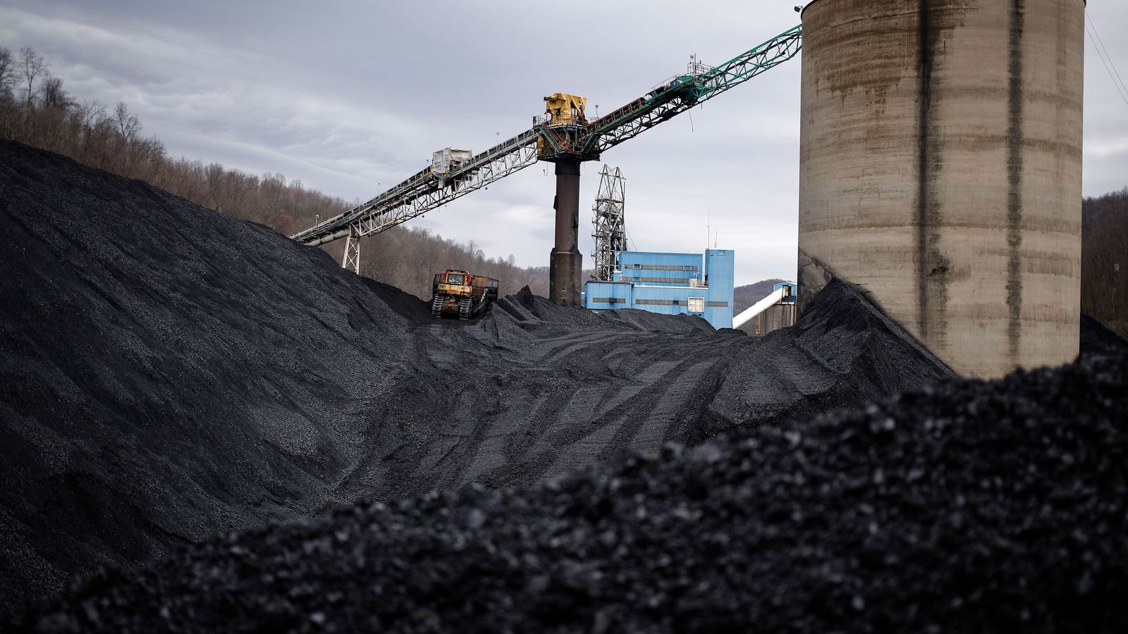 Mounds of unsold coal stand above ground at ERP Compliant Fuels' Federal No. 2 mine near ...