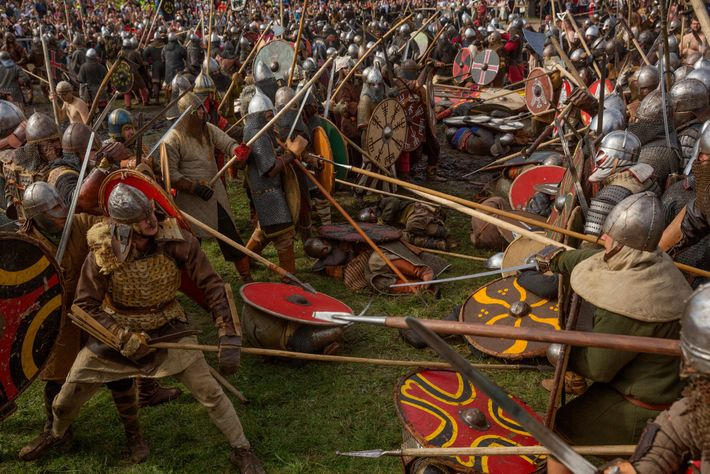 Bristling with spears and swords, Viking and Slav re-enactors face off in a mock battle during ...