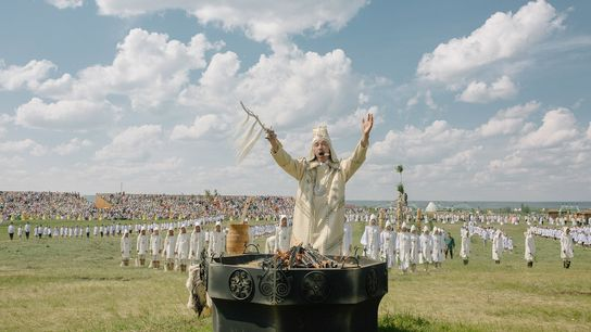 Invoking the sun and other dieties, the algyschyt, or host, opens the Ysyakh festival at Us ...