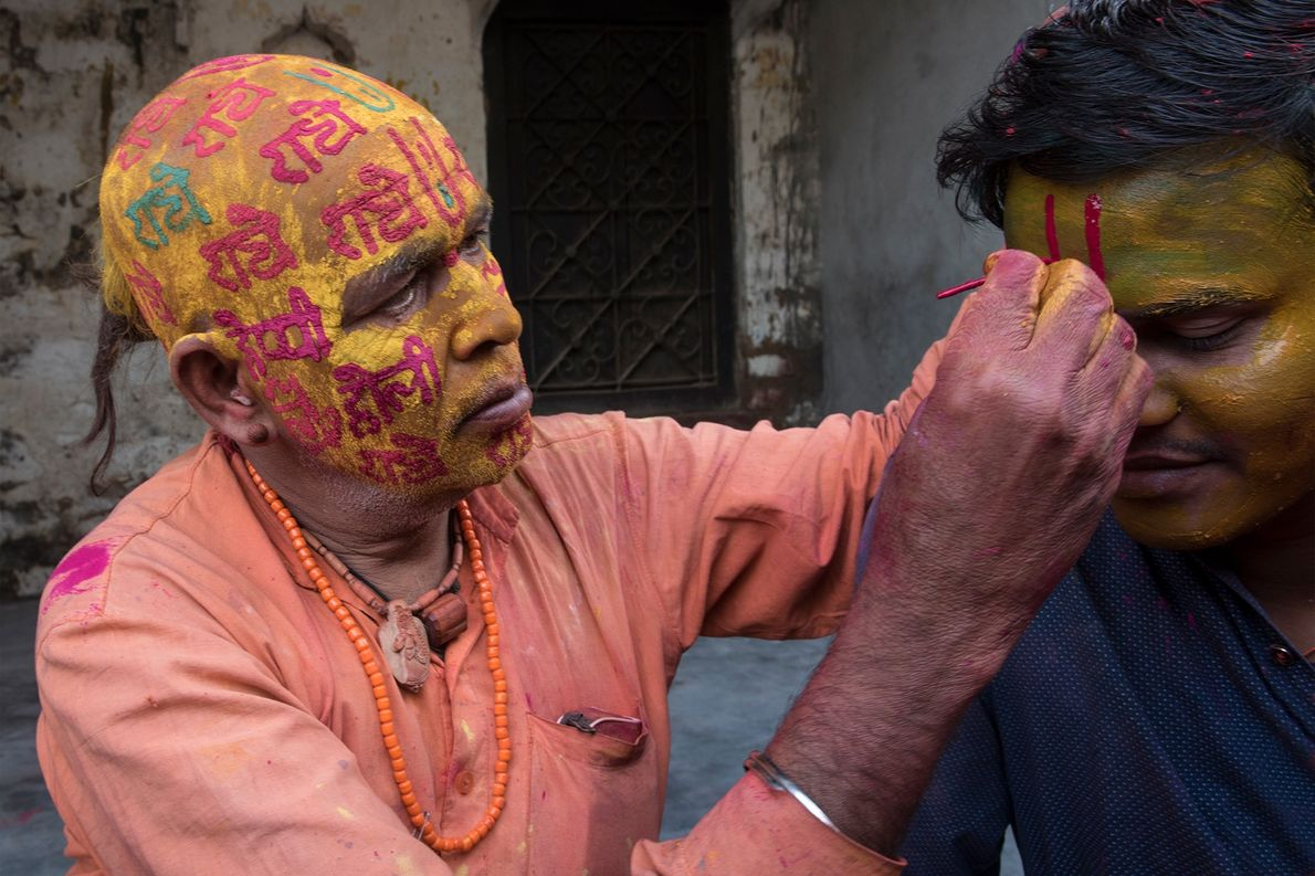 The revellers take time to decorate themselves prior to plunging into the Holi festivities. Face painting ...