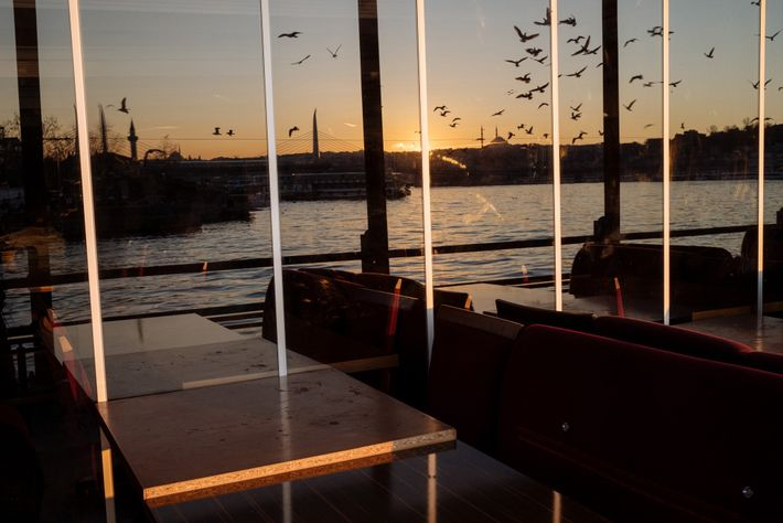 Istanbul restaurants, like this one with views of the Golden Horn inlet of the Bosporus, are ...