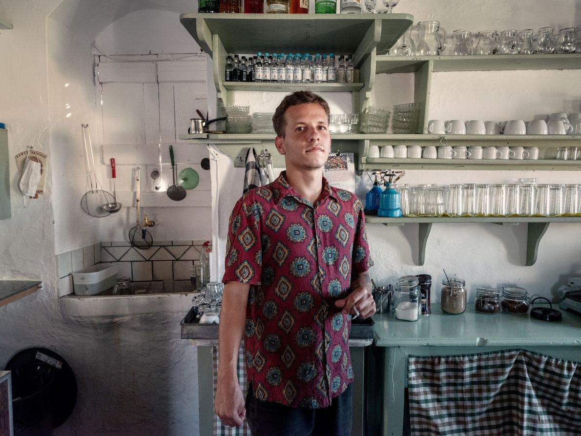 Achilleas Aggelidakis, a graphic designer, works at the café Lygeris, in the town of Akamatra, on ...