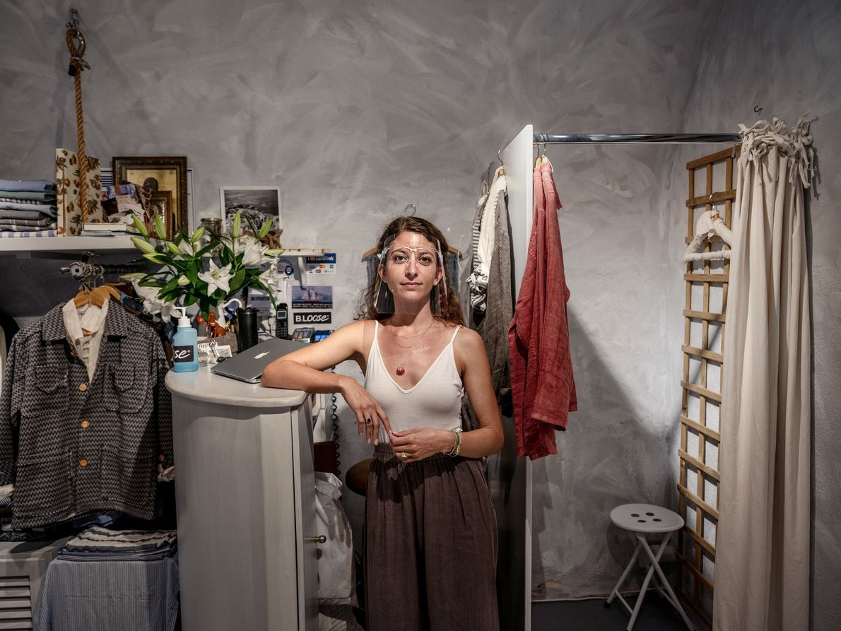 Maria Mantzourani, an employee at B.loose clothing store in Oia, Santorini, says she works less now ...