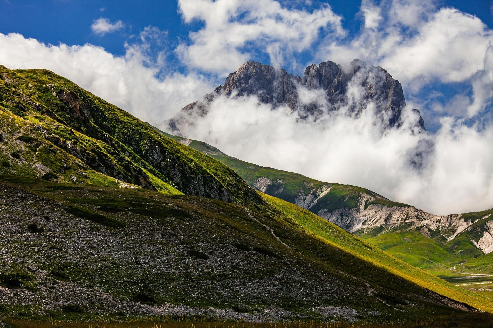 The Corno Grande, the highest peak in the Apennine Mountains, stands out among the clouds. The ...