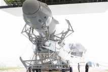 The SpaceX Crew Dragon spacecraft sits perched atop a Falcon 9 rocket ahead of its March ...