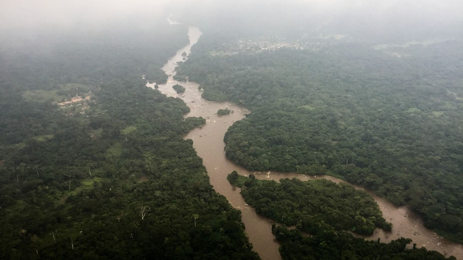 The Epulu River flows through the Okapi Wildlife Reserve, a UNESCO World Heritage site in the ...