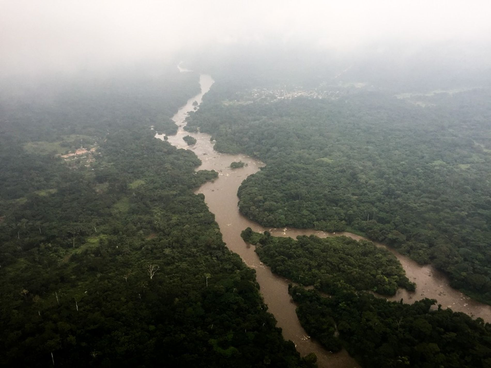 The Epulu River flows through the Okapi Wildlife Reserve, a UNESCO World Heritage site in the conflict-ridden eastern region of the Democratic Republic of the Congo.