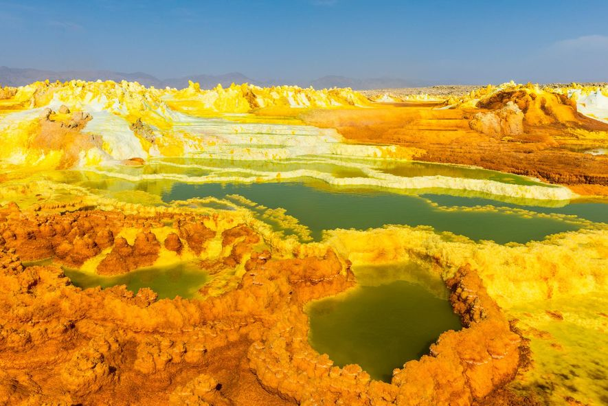 Ethiopia's Danakil Depression is the definition of inhospitable. The sunken volcanic landscape is rife with acidic …