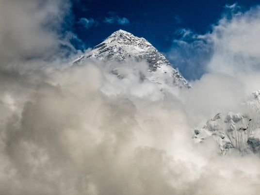 How do you measure Everest? It's complicated by frostbite—and politics.