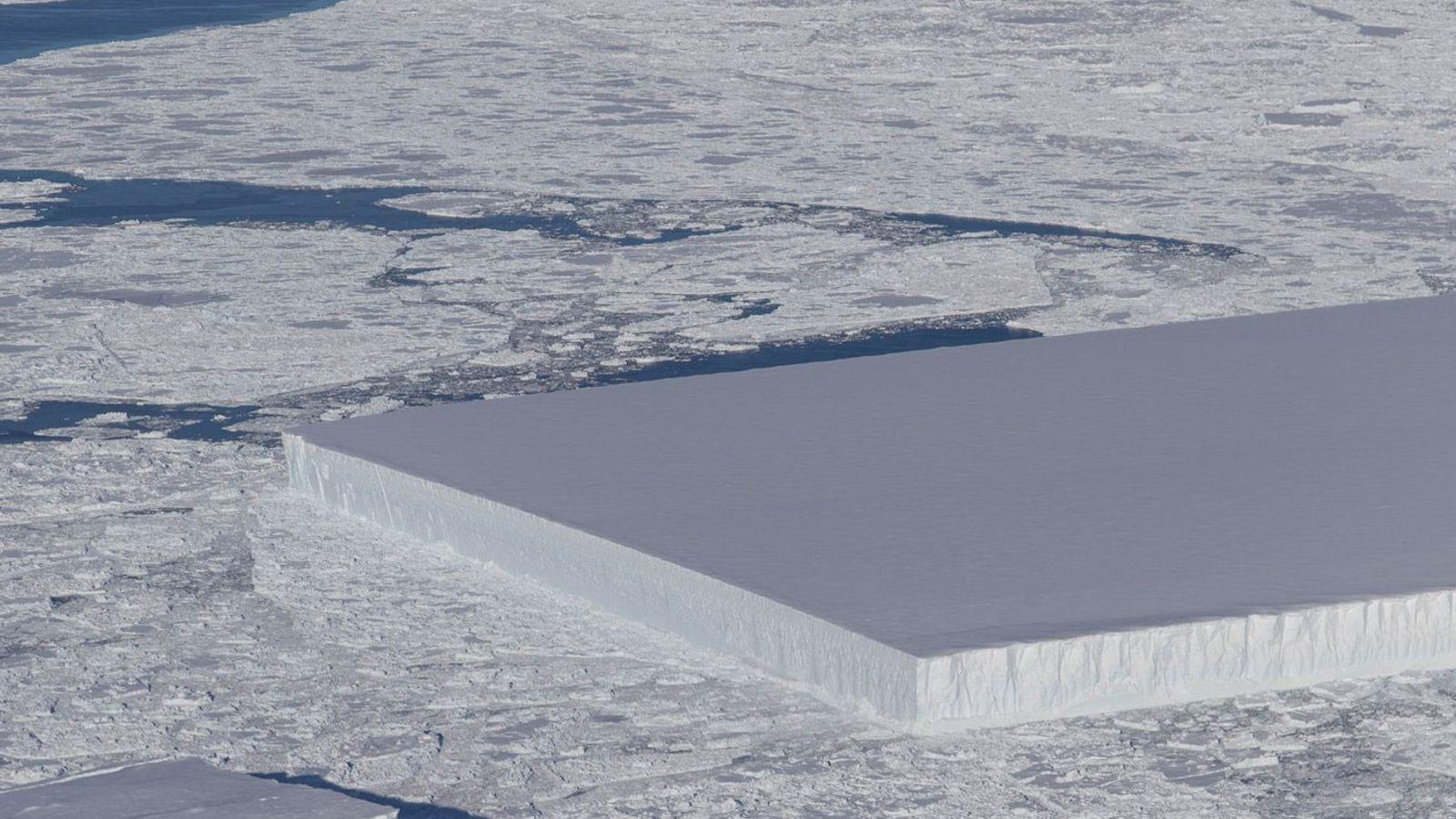 Ice Bridge flight: a tabular iceberg can be seen on the right, floating among sea ice ...
