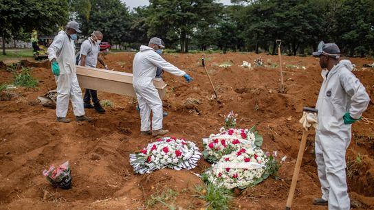 Burying a victim of the coronavirus, at Vila Formosa cemetery in São Paulo, Brazil, Tuesday, April ...