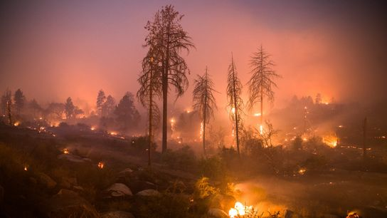 A long exposure shows the Cranston Fire burning on July 25 near Idyllwild, California. The blaze ...