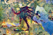 On the walls of a cave in southern Sulawesi, a humanoid figure about five inches wide ...