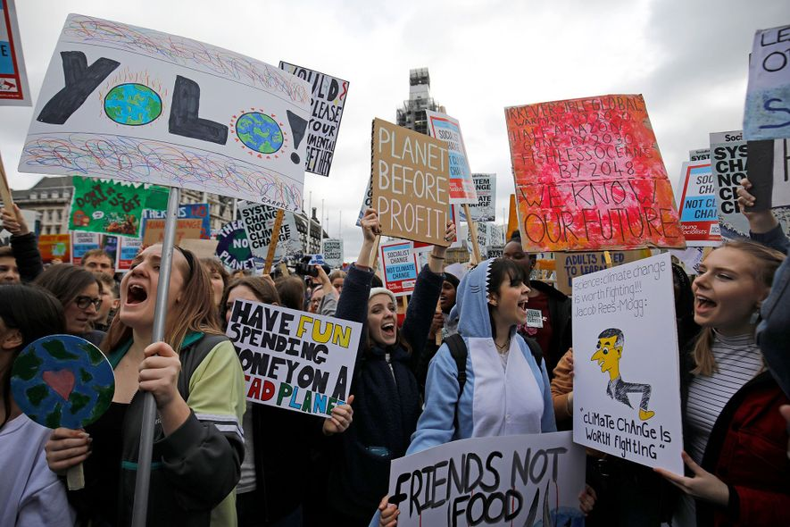 Young demonstrators join a #FridaysForFuture #YouthStrike4Climate event outside the Houses of Parliament in London, England. Hundreds …