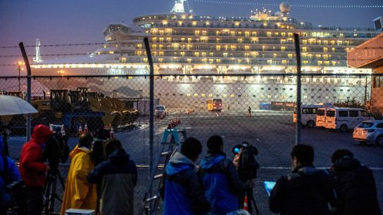 A bus arrives near the cruise ship Diamond Princess, where dozens of passengers tested positive for ...