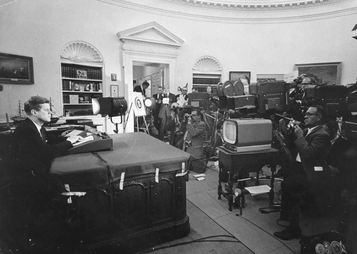 President John F. Kennedy speaks during a televised speech to the nation about the strategic blockade ...