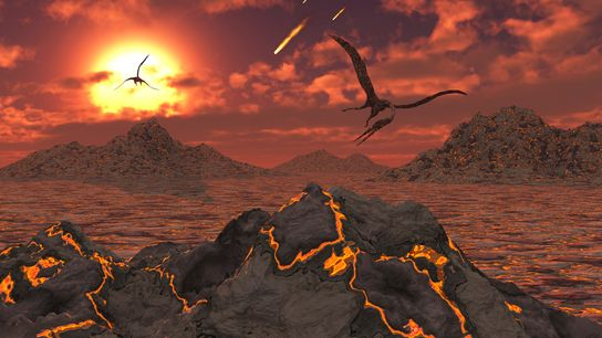 Pterosaurs fly over a volcanic landscape during the mass extinction event that killed the non-avian dinosaurs. ...