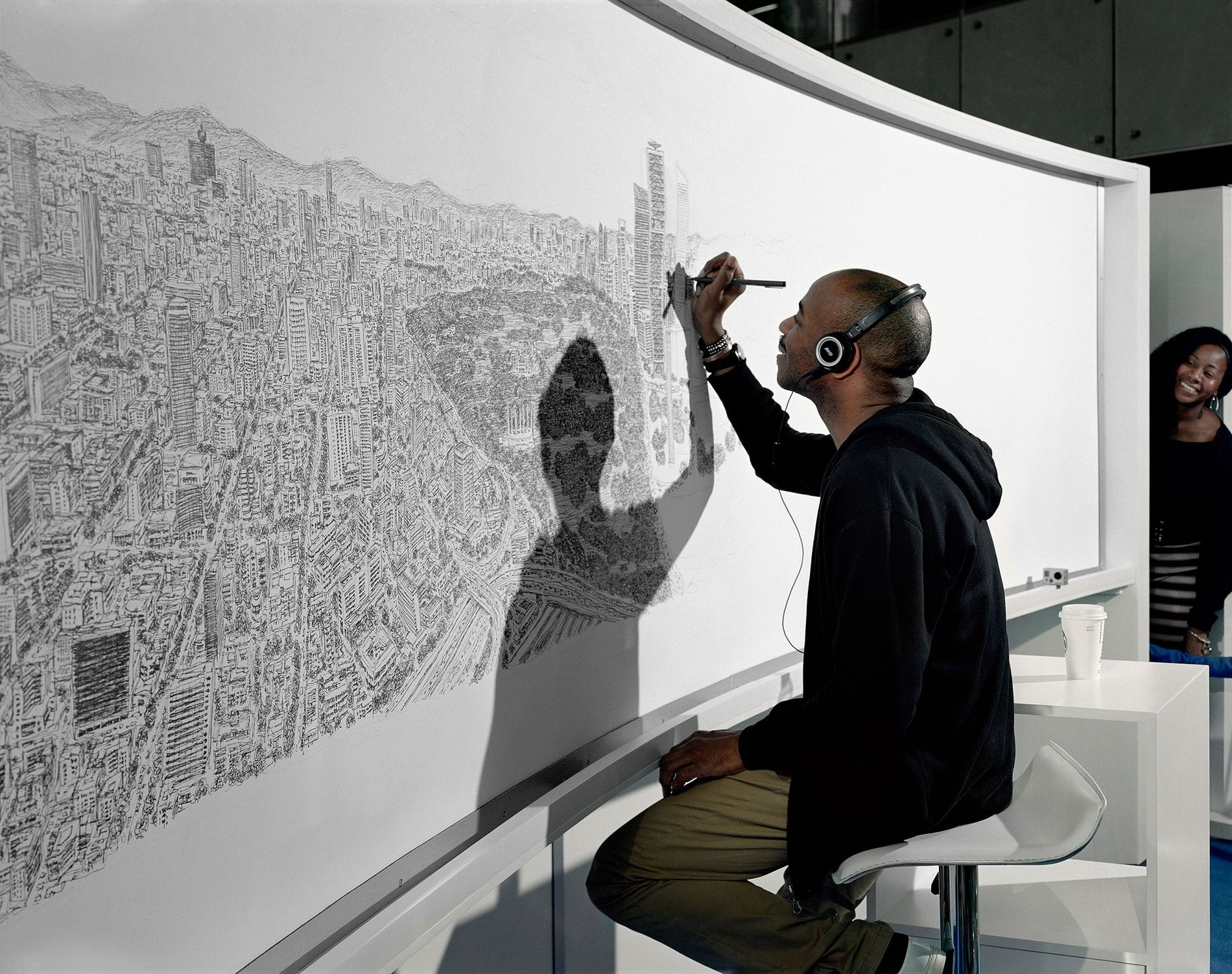 After flying just once over Mexico City, artist Stephen Wiltshire drew the entire cityscape from memory on a 4-metre (13-foot) canvas.