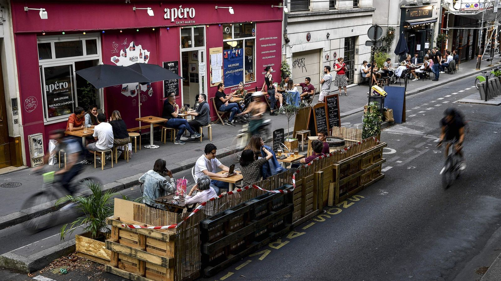In Paris on July 23, 2020, café patrons sip drinks on an extended terrace made of ...
