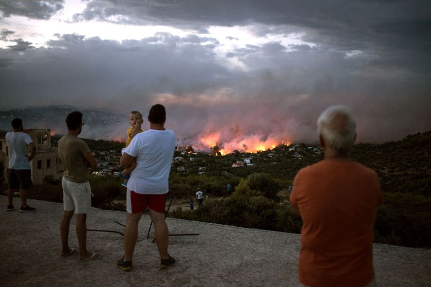 A wildfire rages near the town of Rafina, near Athens, Greece, on July 23, 2018. At ...