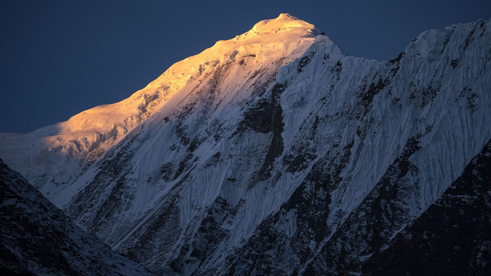 Sunrise strikes the Himalayan peaks on November 8, 2018, as seen from Manang, Nepal.