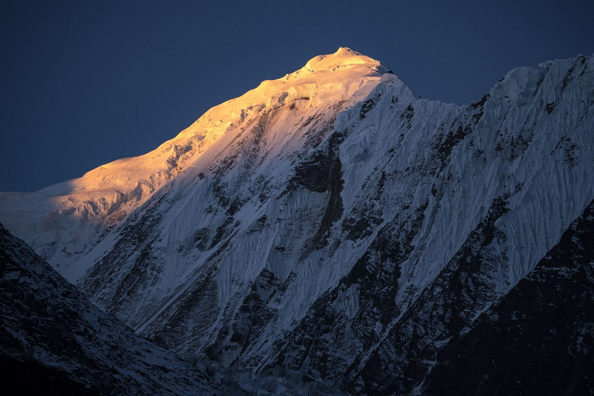 Sunrise strikes the Himalayan peaks on November 8, 2018, as seen from Manang, Nepal.  ...