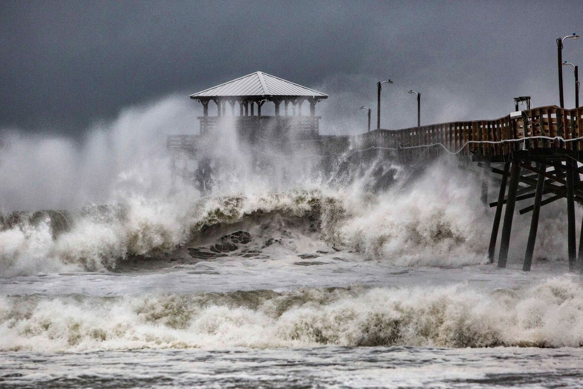 Waves slam into a pier in Atlantic Beach, North Carolina on Thursday. Hurricane Florence officially made ...