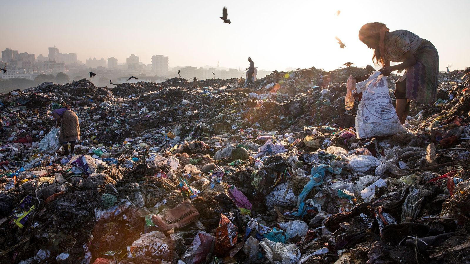 In Kalyan, on the outskirts of Mumbai, India, trash pickers look for sellable plastics at the ...