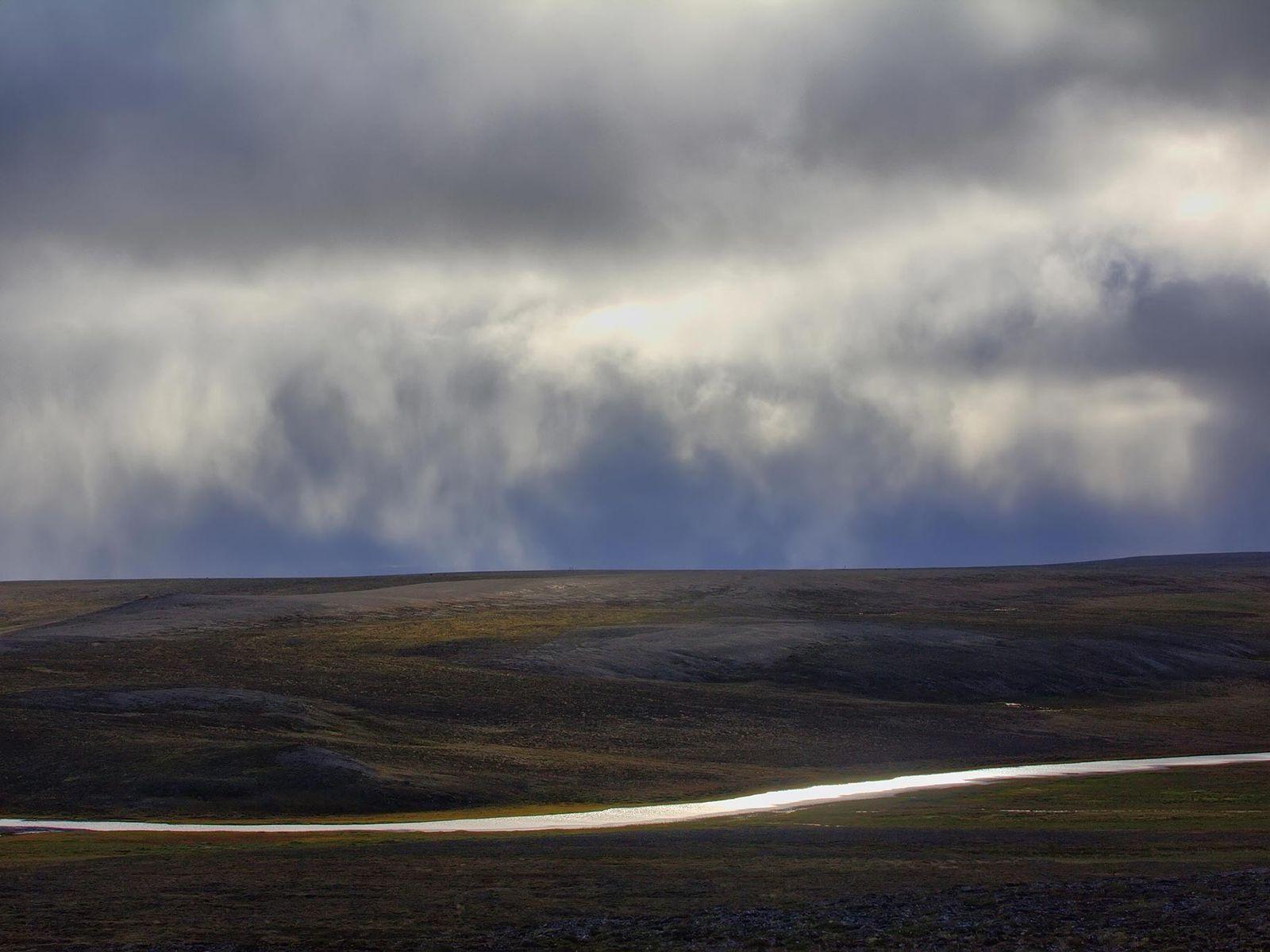 Water flows across a ridge of the Novaya Zemlya archipelago, one of the nuclear test sites ...