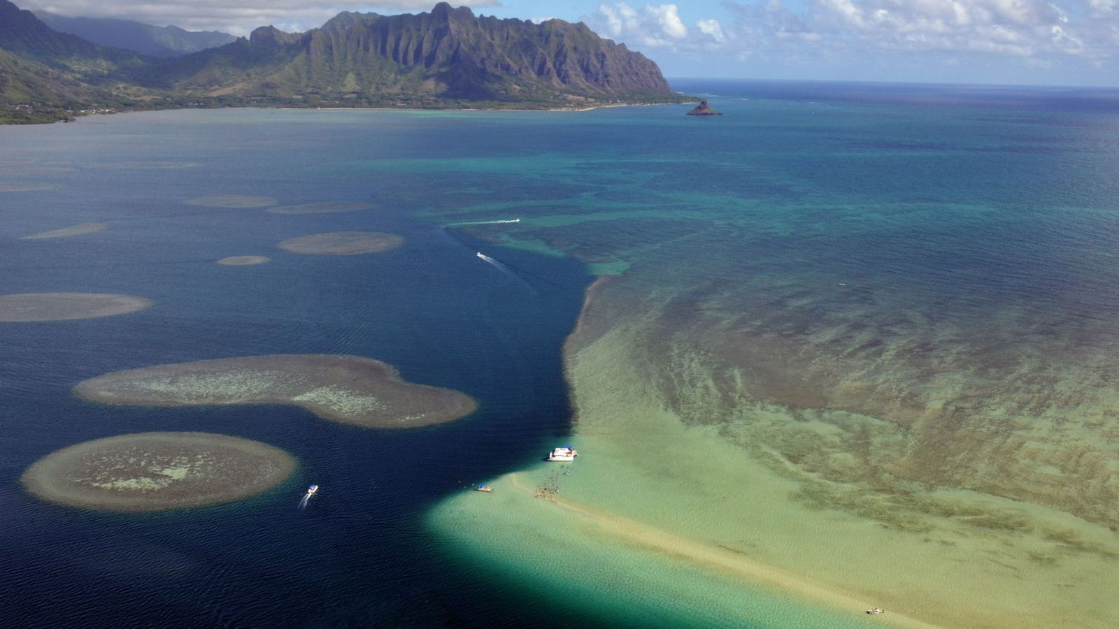 An aerial view of sandbars and coral reefs in Kaneohe Bay, Oahu, Hawaii, USA