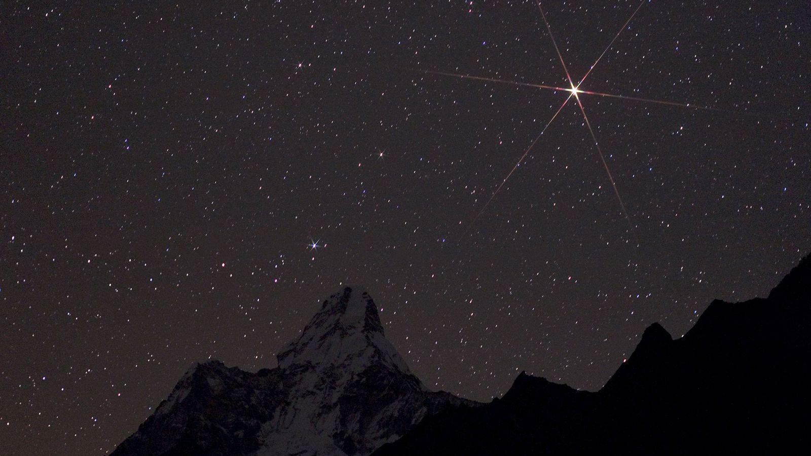 Brilliant Mars rises over Sagarmatha National Park in Nepal.