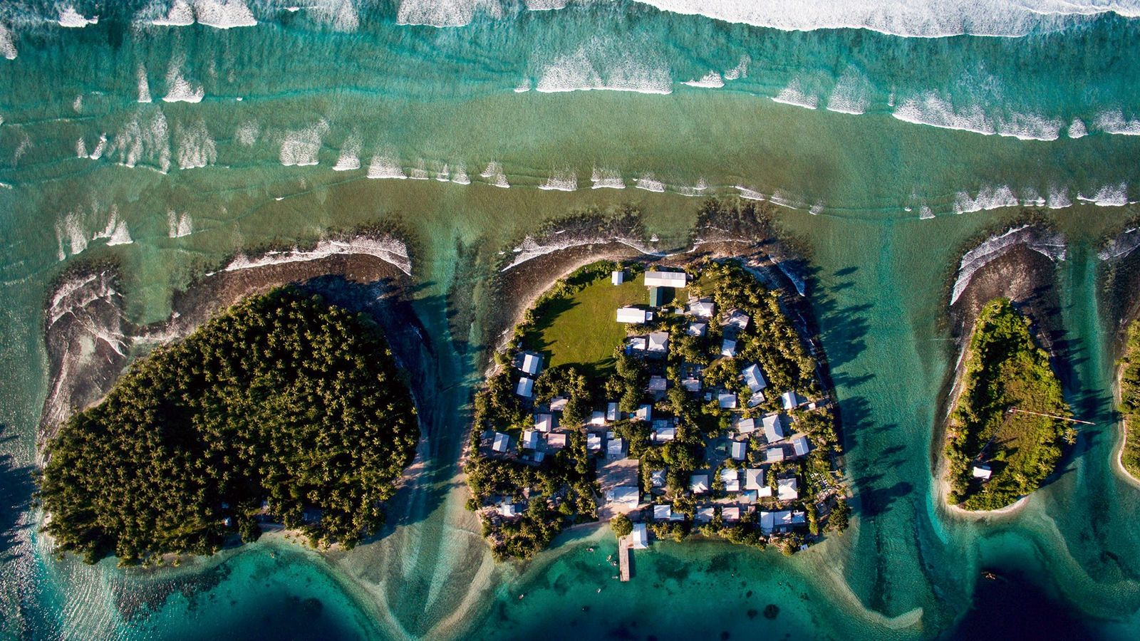 An overhead view of Ejit in the Marshall Islands, center, where rising sea levels are already ...
