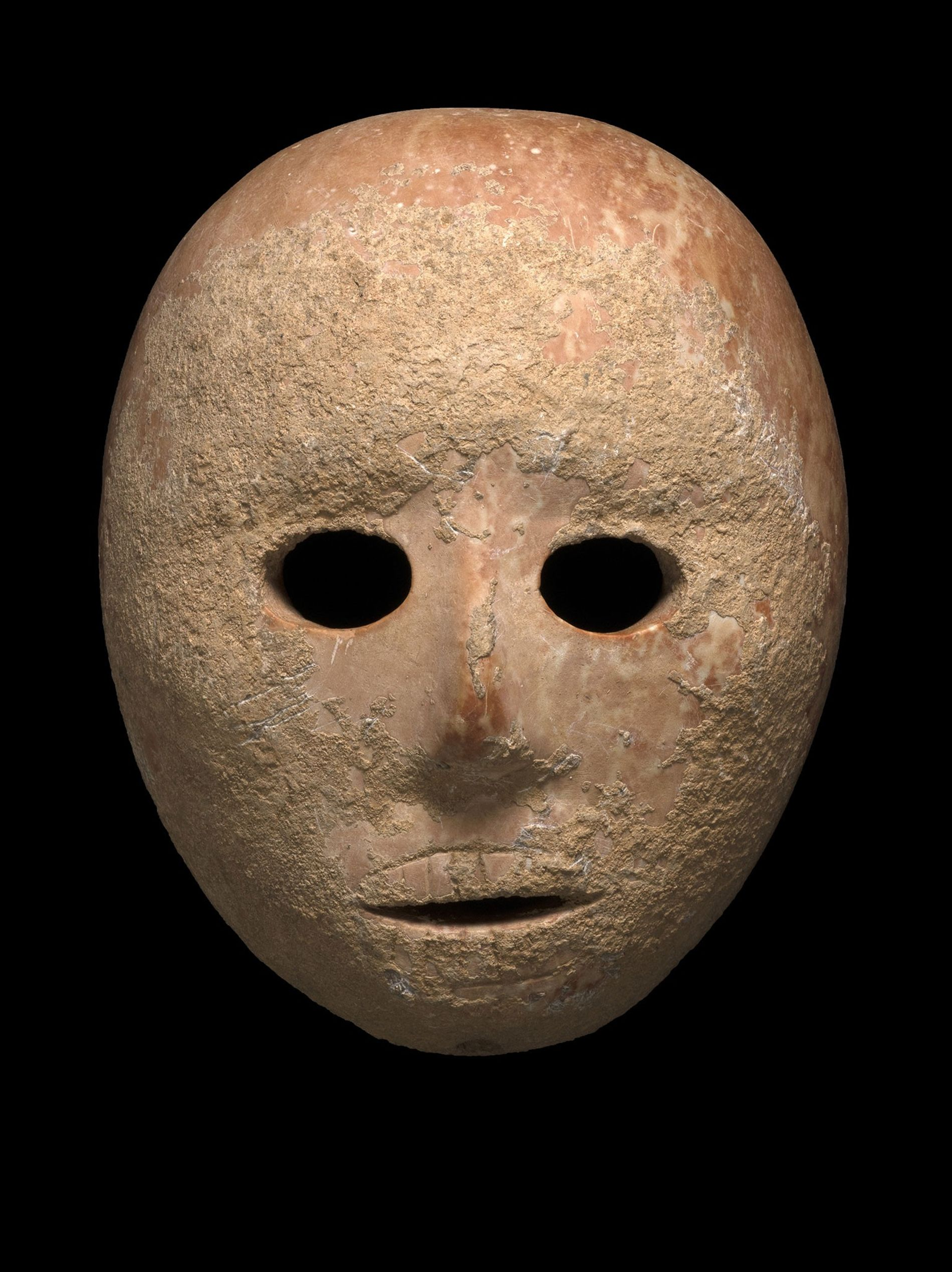 This 9,000-year-old limestone mask was recently recovered by Israeli anti-looting authorities.