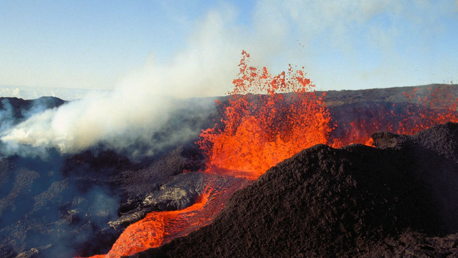 Lava bursts forth from Mauna Loa in Hawaii, which once again holds the title as the ...