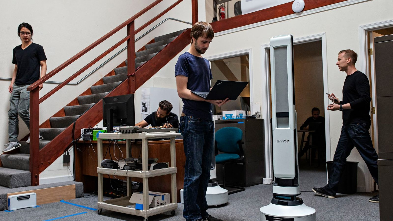 Senior robotics engineer Steven Macenski works on robot perception with the Tally robot, which is designed ...