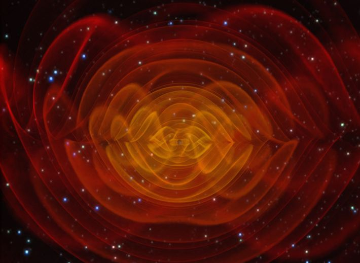 A computer simulation shows the gravitational waves emitted by two gigantic black holes spiralling around each ...
