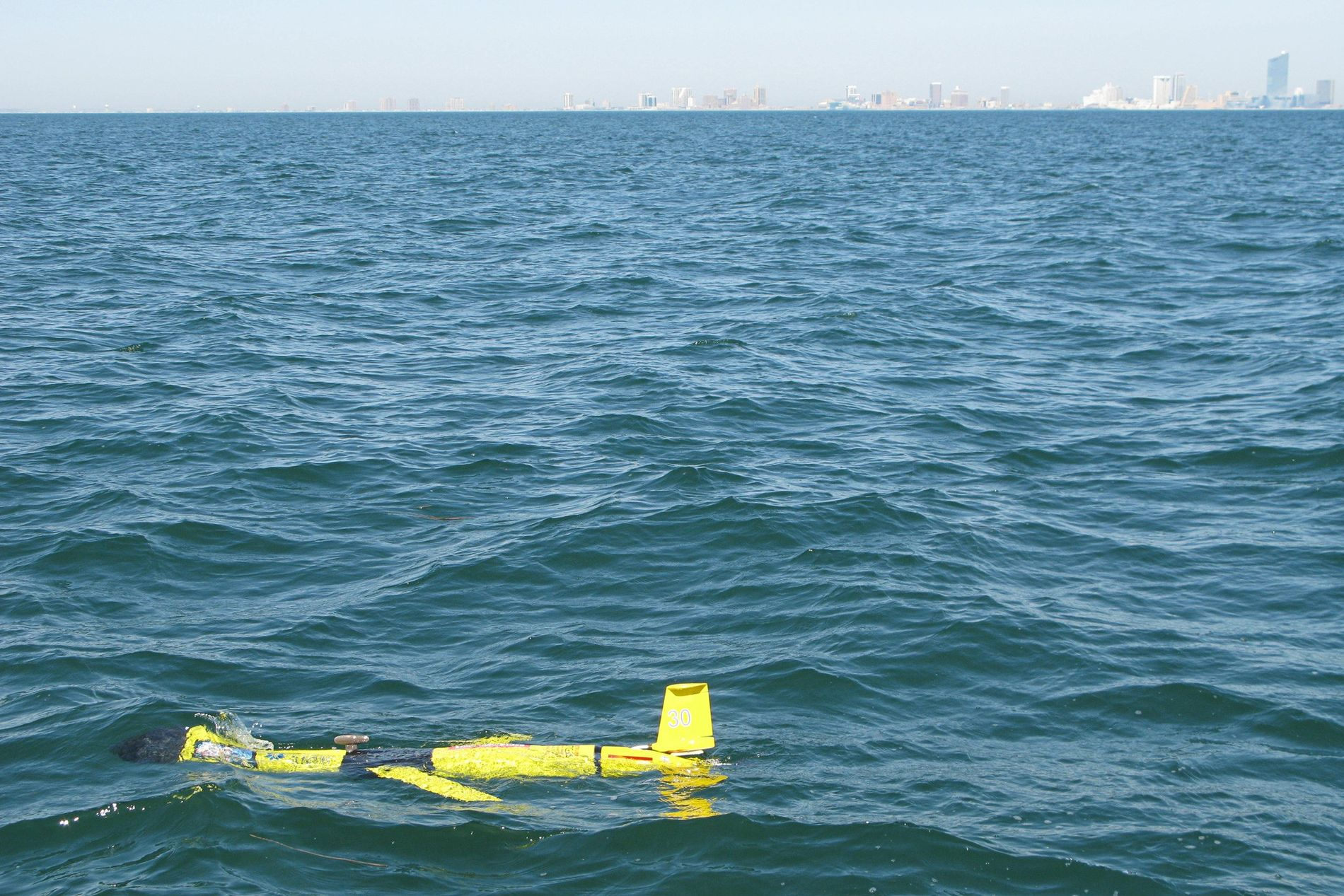 An autonomous glider floats about two miles off Atlantic City, after being deployed by a team ...