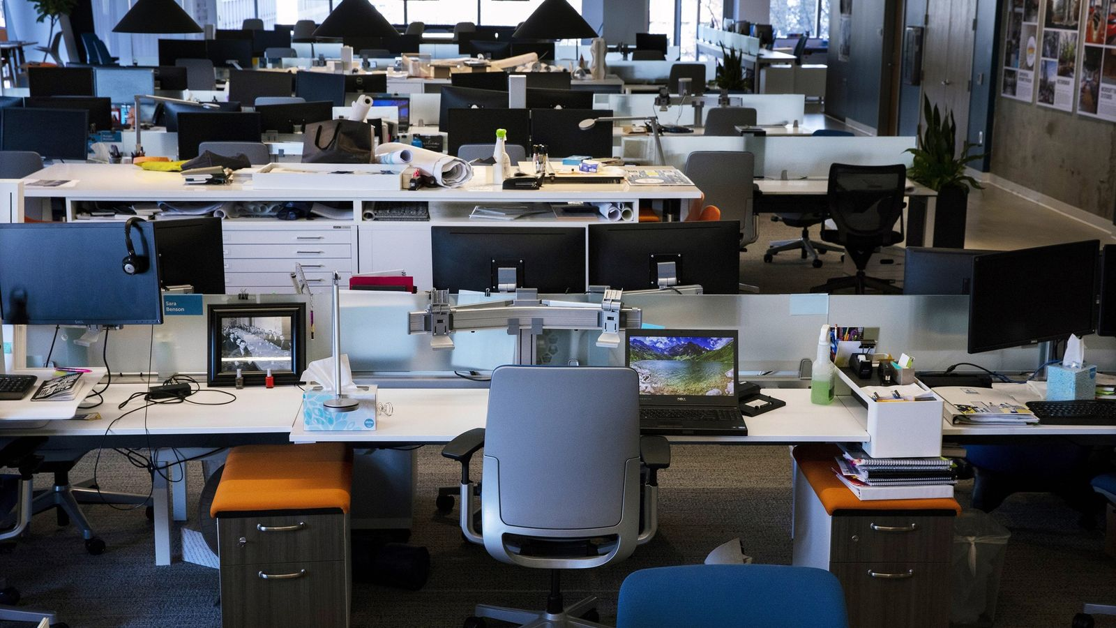 "Desks are arranged lined up side​ by side, or ""benching,"" in the S​eattle office of B+H ..."