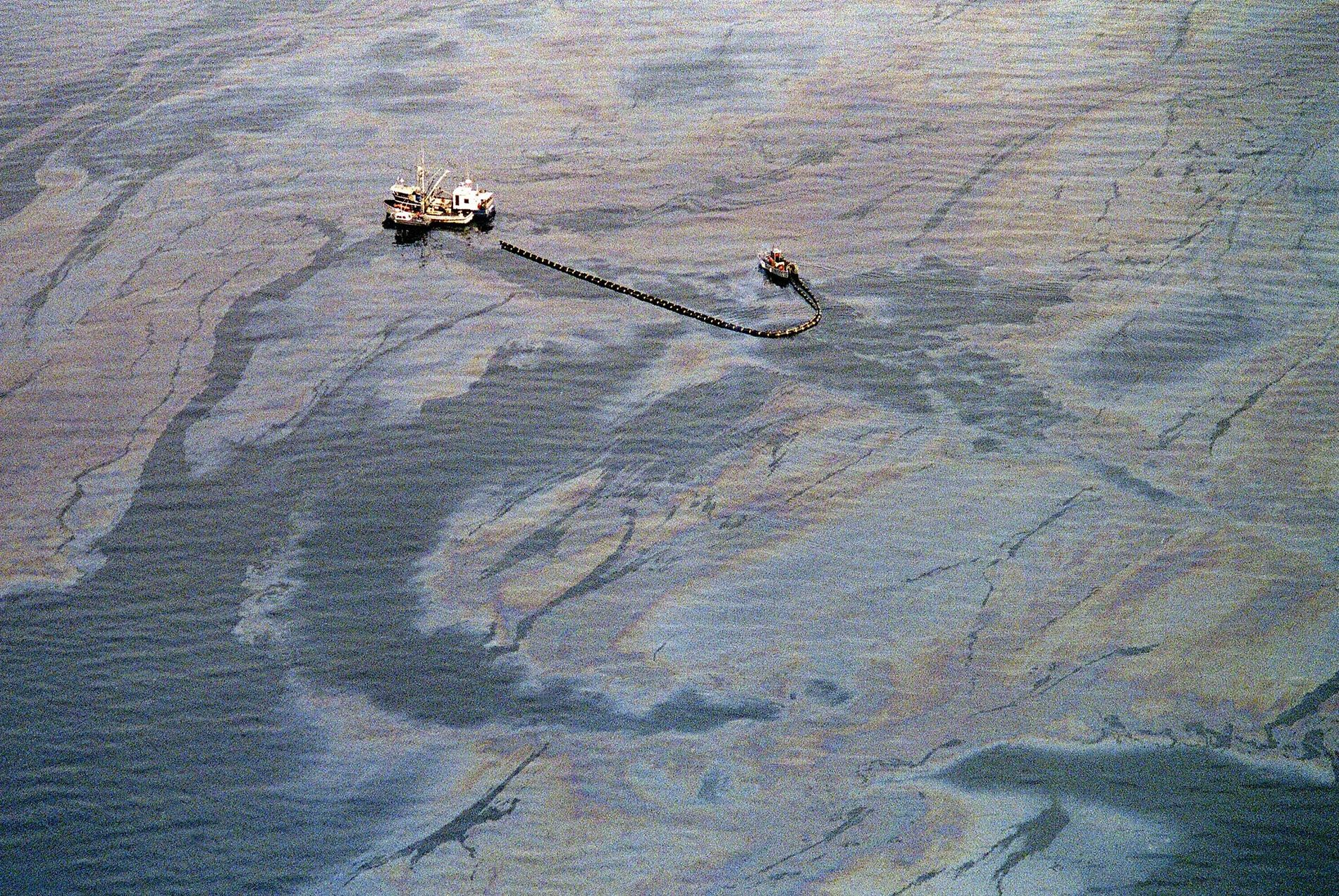 An oil skimming operation works in a heavy slick near Latouche Island in the southwest end ...