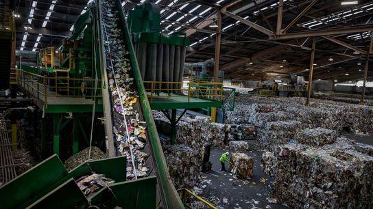 A conveyor belt carries mixed plastic to an optical sorter.