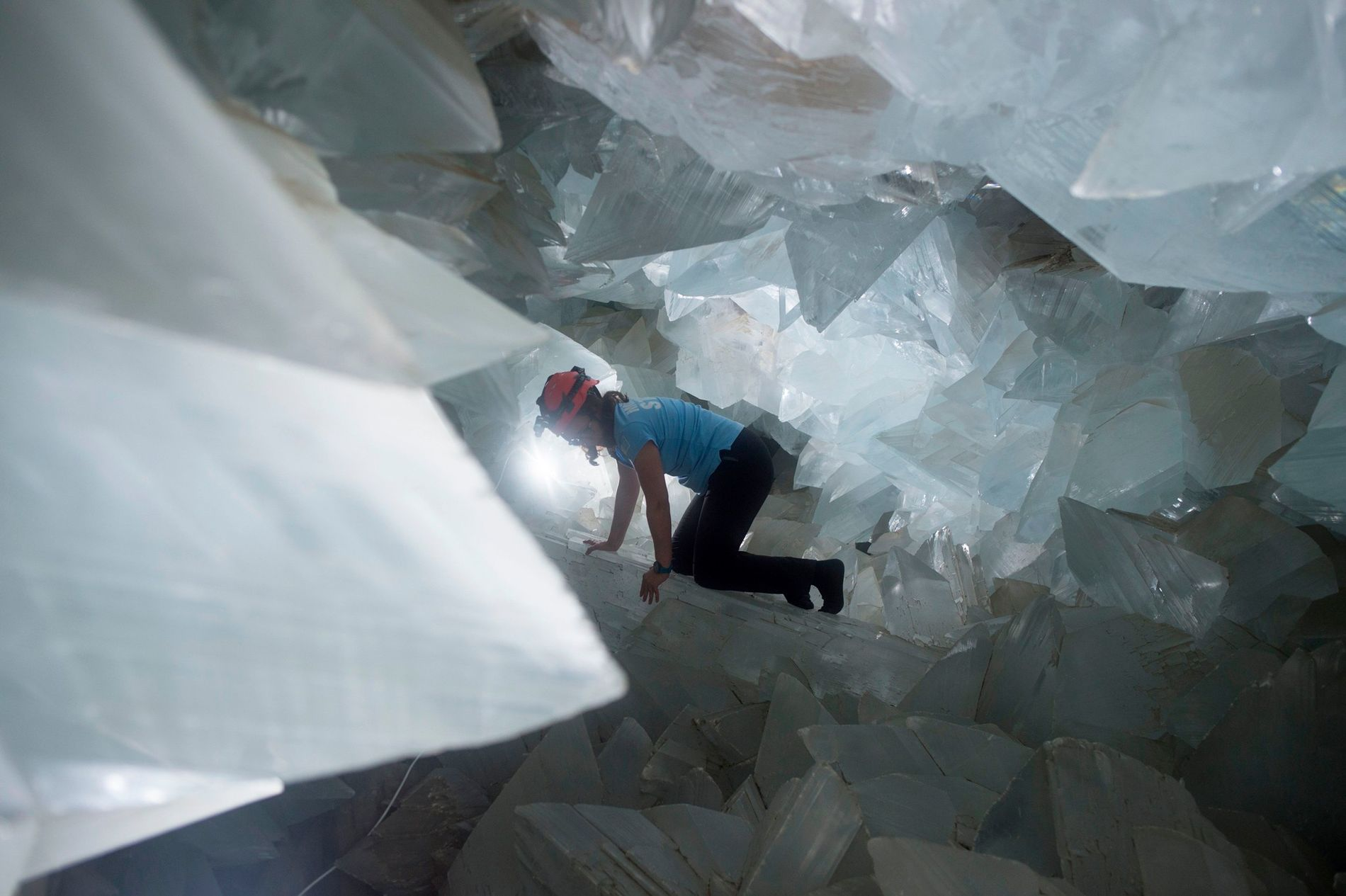 Geologist Milagros Carretero maneuvers through the gigantic Pulpí Geode in Spain in August 2019.