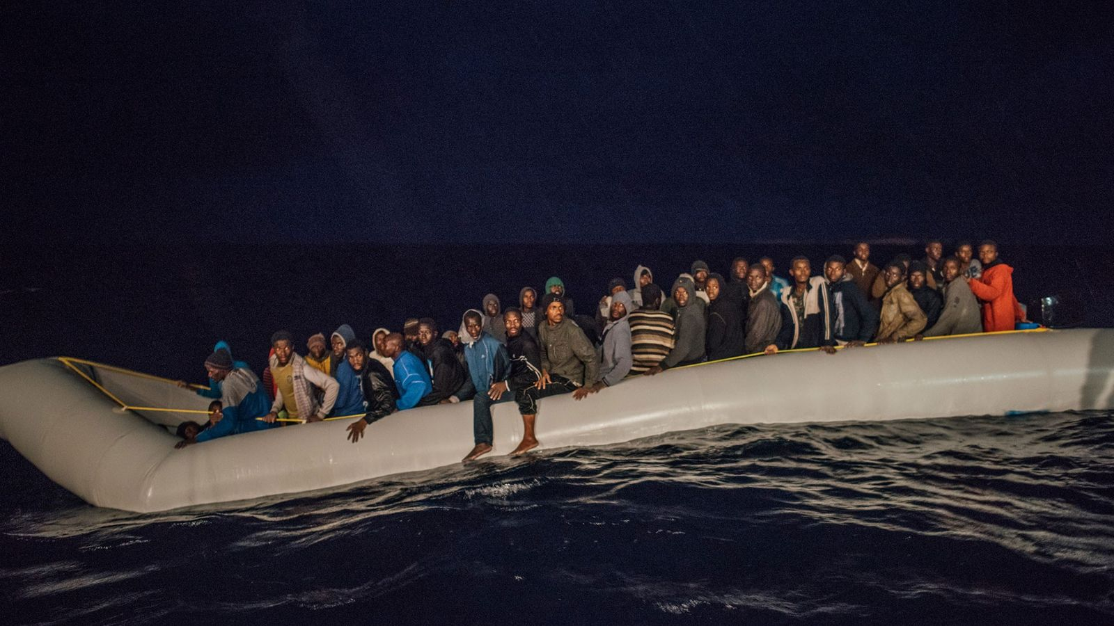 The MS Aquarius spots this dinghy in distress with 112 people on board, just as it ...