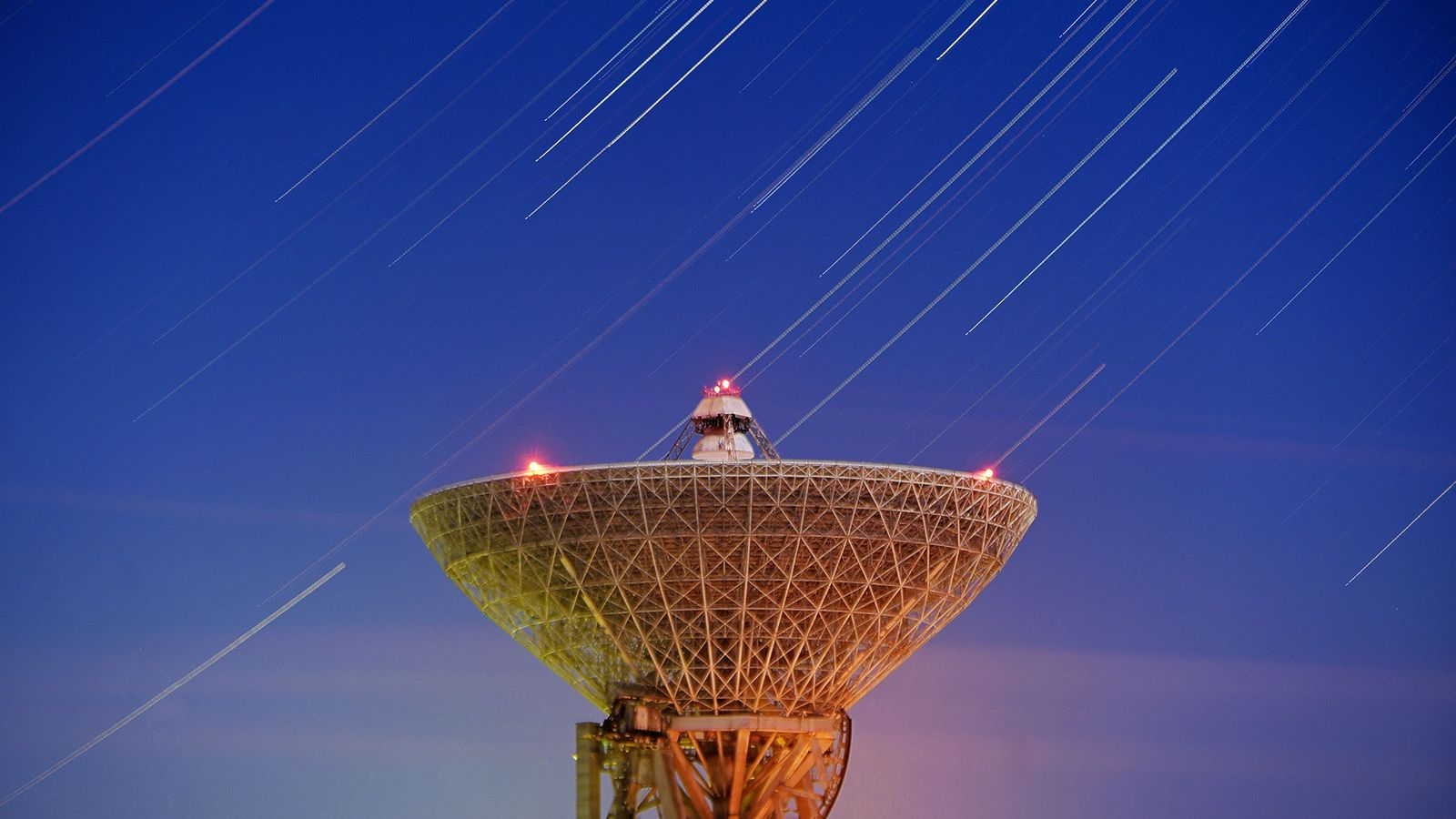 The annual Geminid meteor shower lights up the sky over the Galenki RT-70 radio telescope in ...