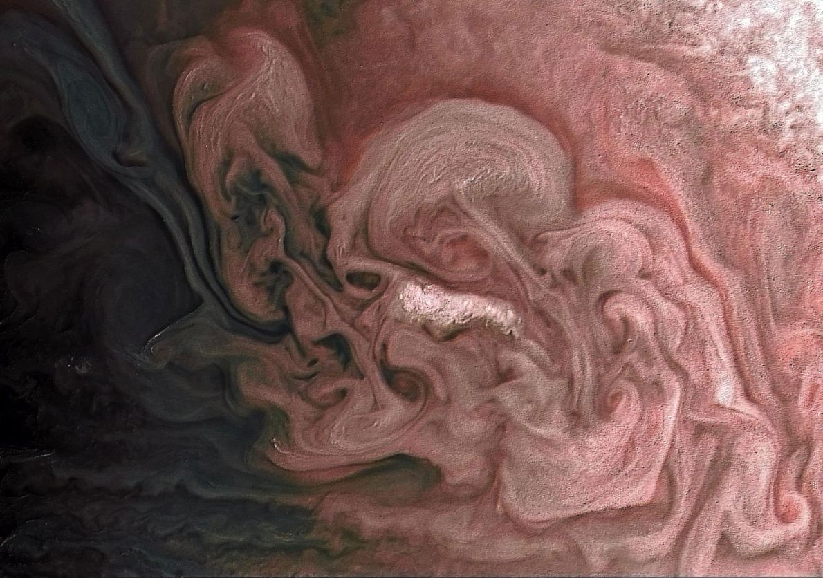 NASA's Juno spacecraft caught these stunning swirls of clouds from 7,578 miles above Jupiter. The orbiter ...
