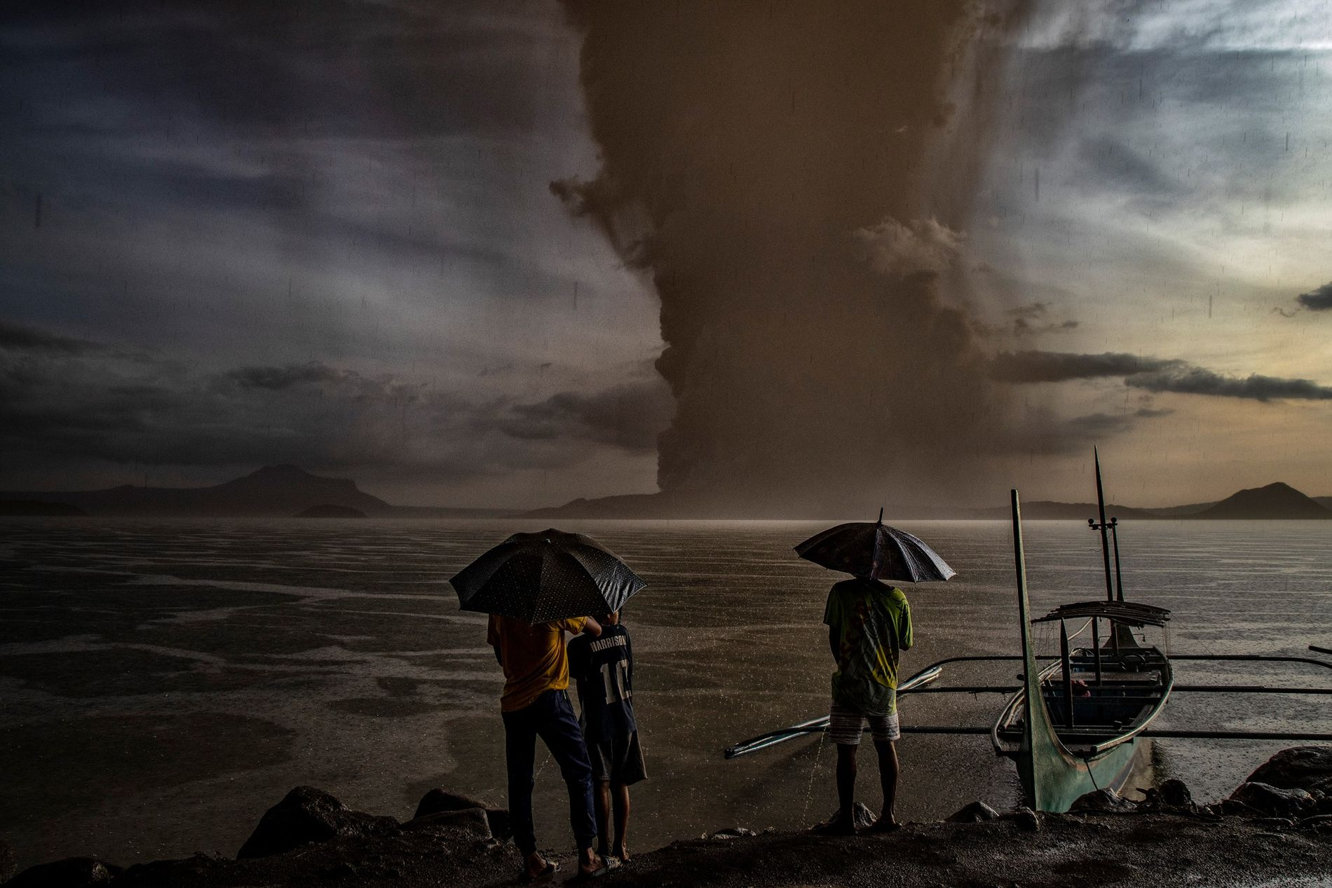 An ash cloud rises over the lake as Taal Volcano erupts in the Philippines on January ...