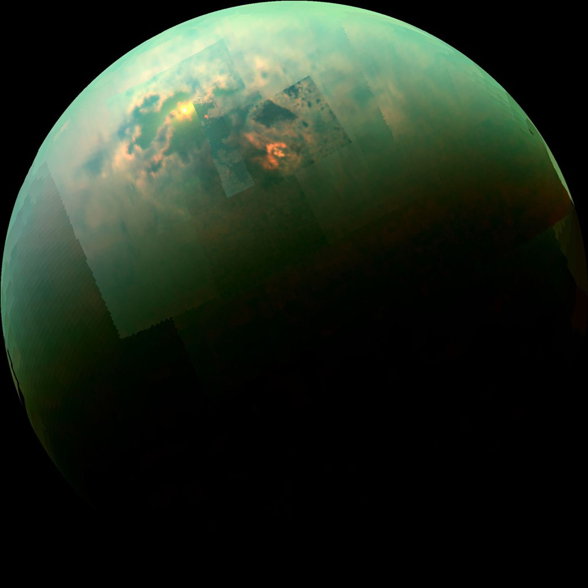 This near-infrared, colour mosaic from NASA's Cassini spacecraft shows sunlight glinting off of Titan's north polar ...